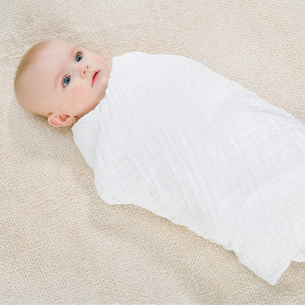 How to swaddle a baby step by step
