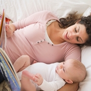 Mom reads a book to the baby - Aden and Anais