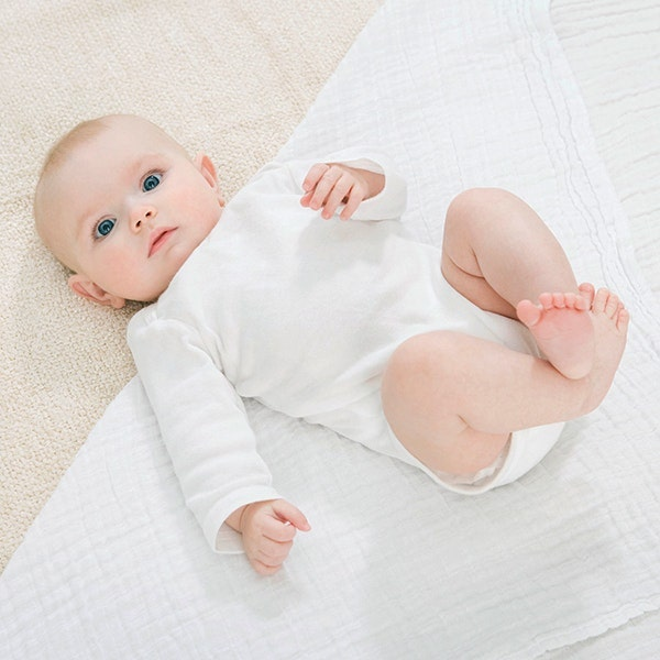 Baby laying on a swaddle blanket