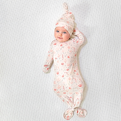Baby wearing the comfort knit collection gown and hat