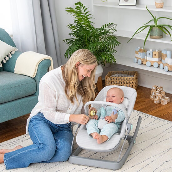 mom with baby in baby bouncer rocker chair