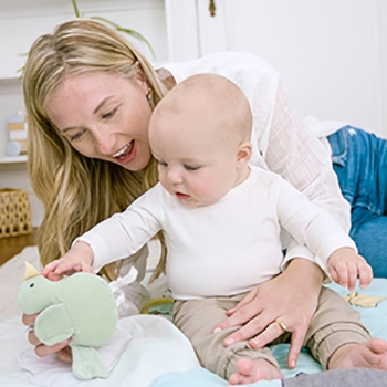 Mom and baby play with plush toy - Aden and Anais