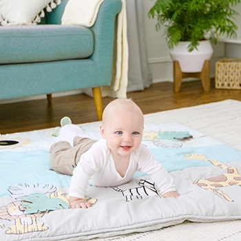 baby laying on playmat