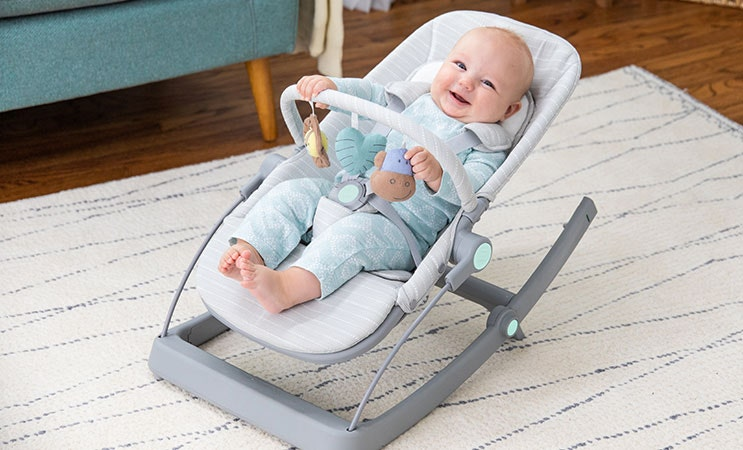 baby sitting in aden and anais baby bouncer rocker chair