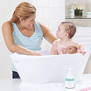 Mom bathes baby - Aden and Anais