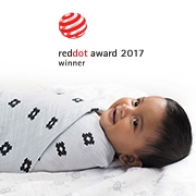 Swaddled baby lies on Aden and Anais blanket - reddot award 2017