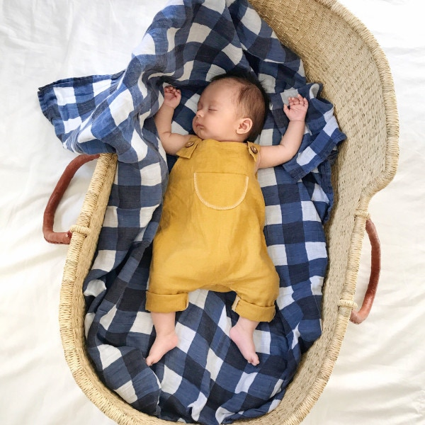 Baby sleeping in a basket - Aden and Anais