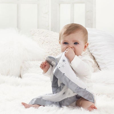 Baby with small Aden and Anais blanket