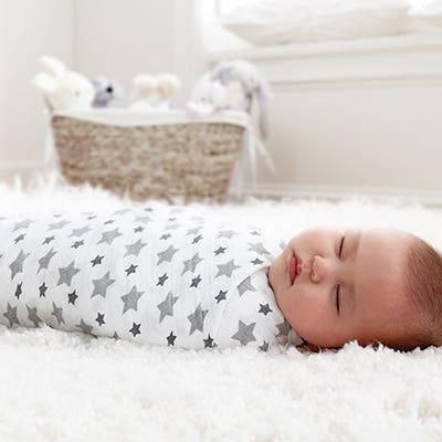 Sleeping, swaddled baby