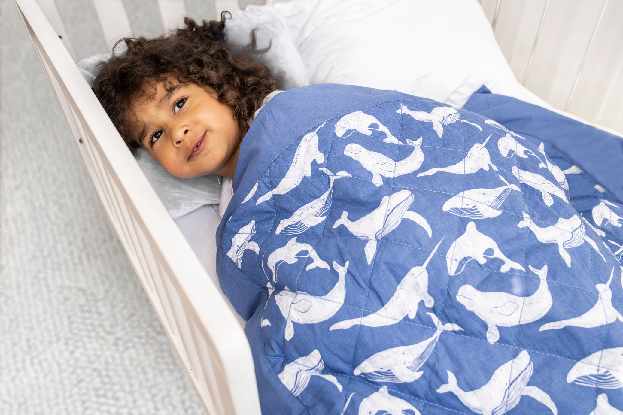 toddler boy in bed with toddler-bed weighted blanket 2.65 lbs whale watching